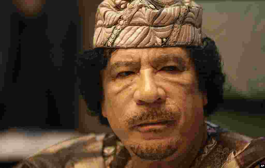Libyan leader Moammar Gadhafi attends the closing session of the Arab League Summit in the Libyan coastal city of Sirte on March 28, 2010. Arab leaders met behind closed doors to thrash out a united strategy against Israel's settlement policy as the Jewis