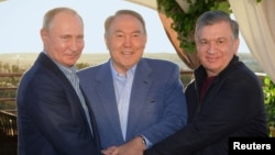 FILE - Russian President Vladimir Putin, left, Kazakh President Nursultan Nazarbayev, center, and Uzbek President Shavkat Mirziyoyev meet in Saryagash, Southern Kazakhstan, Oct. 20, 2018.
