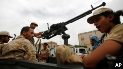 Shi'ite fighters known as Houthis wearing army uniforms ride in a pickup while patrolling in a street in Sana'a, Yemen, July 24, 2015.