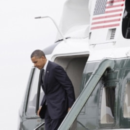 President Obama steps off of Marine One at Dover Air Force Base, Del., Aug. 9, 2011.