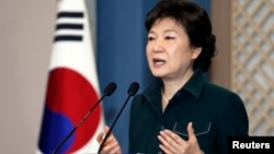 South Korea's President Park Geun-hye speaks to the nation at the presidential Blue House in Seoul, March 4, 2013 file photo.