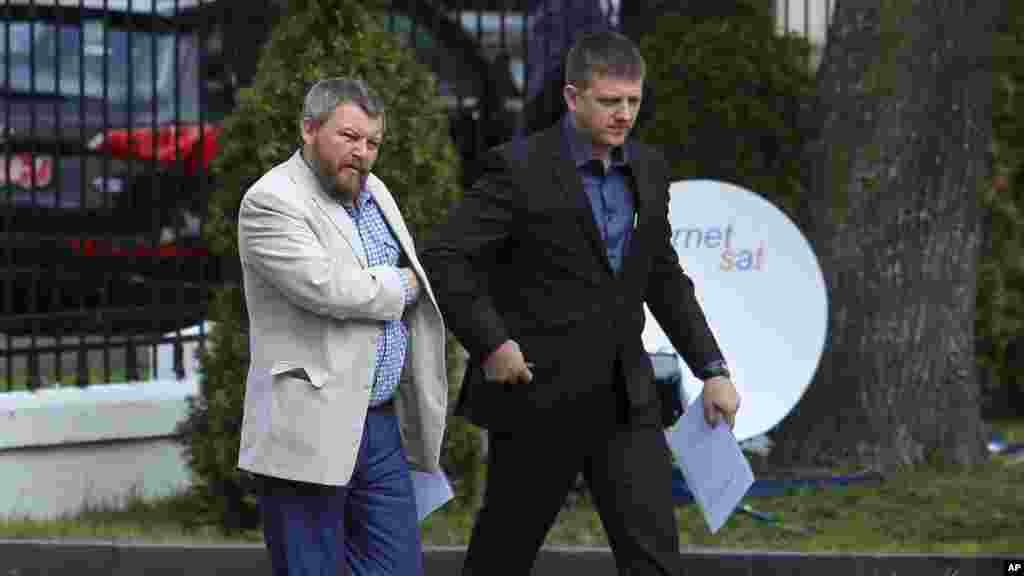 Pro-Russian rebel leaders from Eastern Ukraine Andrei Purgin, left, and Alexey Karyakin walk in Minsk, Belarus, Sept. 1, 2014.