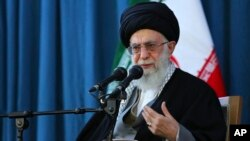 FILE - In this picture released by an official website of the office of the Iranian supreme leader on Sunday, March 20, 2016, Ayatollah Ali Khamenei speaks to a crowd in the northern city of Mashhad, Iran.