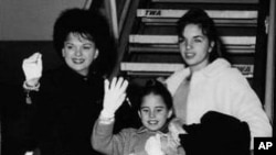 Judy Garland, background, left, waves with her children, Liza, 15, top right, Lorna, 9, center, and Joe, 6, on Jan. 2, 1962, as they were about to board a plane at New York International Airport