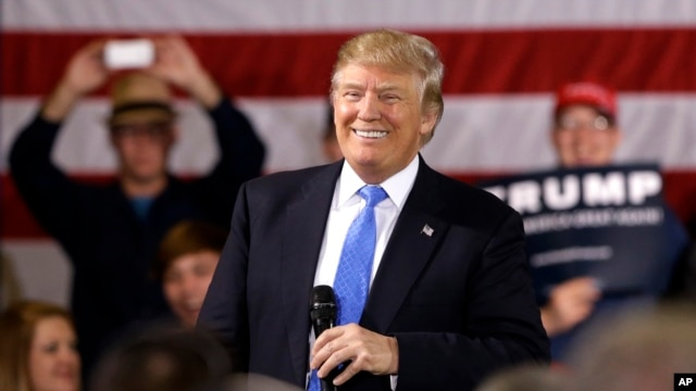 Republican presidential candidate Donald Trump smiles as he speaks at a campaign stop Tuesday, March 29, 2016.
