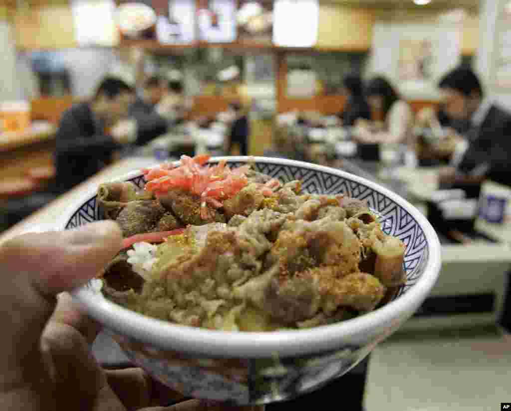 """Gyudon,"" or a rice dish topped with American beef, is shown at a restaurant of Japanese fast-food chain Yoshinoya D&C Co. in Tokyo, Thursday, April 24. 2008."