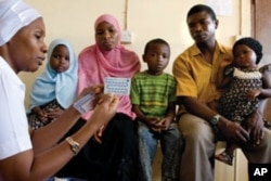 A family receives family planning advice at Kivunge Hospital, Zanzibar