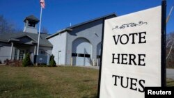A sign marks the polling place for voters in Kennebunkport, Maine, Nov. 3, 2014.