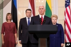 U.S. Vice President Mike Pence, second from right, accompanied by the leaders of Baltic states, from left, Estonian President Kersti Kaljulaid, Latvian President Raimonds Vejonis and Lithuanian President Dalia Grybauskaite, speaks during a news conference following their meeting in the Kadriorg Palace in Tallinn, Estonia, July 31, 2017.