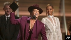 "FILE - Bruno Mars accepts the award for record of the year for ""Uptown Funk"" at the 58th annual Grammy Awards in Los Angeles."