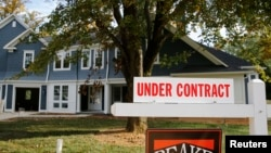 "FILE - A real estate sign advertising a home ""Under Contract"" is pictured in Vienna, Virginia, outside of Washington, D.C."