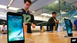FILE - The Apple iPhone 7 is displayed at an Apple store at the Grove in Los Angeles, California, Sept. 16, 2016.