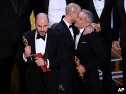 "Jordan Horowitz, left, of ""La La Land,"" mistakenly accepts the award for best picture at the Oscars on Sunday, Feb. 26, 2017, at the Dolby Theatre in Los Angeles. It was later determined that ""Moonlight,"" won best picture."