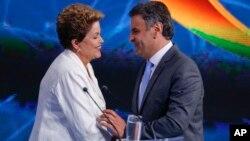 Dilma Rousseff y Aecio Neves se enfrentarán en la segunda vuelta el 26 de octubre.