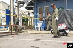Investigators work at the scene of an explosion in the resort town of Hua Hin, 240 kilometers (150 miles) south of Bangkok, Aug. 12, 2016.