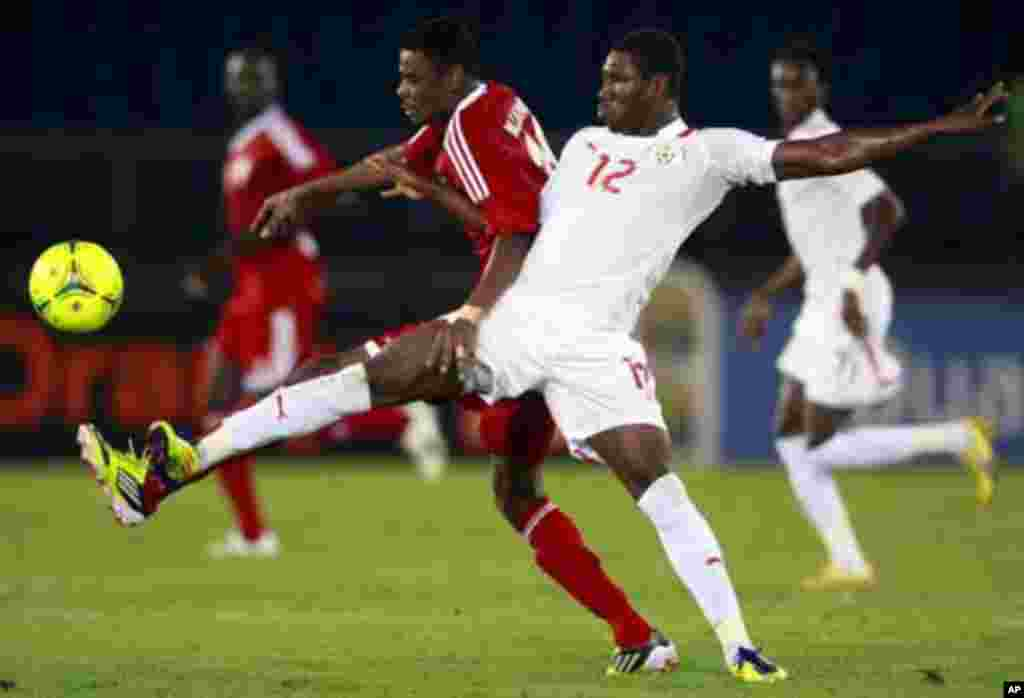 "Prejuce Nakoulma of Burkina Faso (R) fights for the ball with Mohamed Ahmed of Sudan during their African Nations Cup Group B soccer match at Estadio de Bata ""Bata Stadium"", in Bata January 30, 2012."