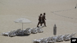 Mexican soldiers patrol the beach of San Jose del Cabo in Mexico's Baja Peninsula, Sunday, June 17, 2012. The G-20 summit starts in Los Cabos on Monday.