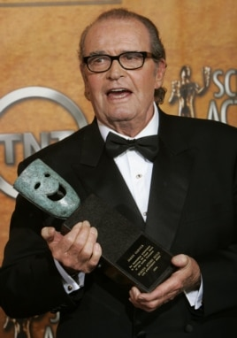 James Garner smiles with his award at the 11th annual Screen Actors Guild awards at the Shrine Auditorium in Los Angeles, Feb. 5, 2005.