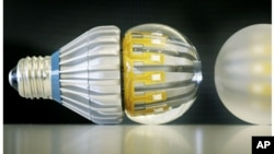 FILE - Switch75 light LED bulbs in clear and frosted, Nov. 8, 2011. California on Wednesday became the first state to set energy efficiency standards for household LEDs and smaller track-lighting-style light bulbs.