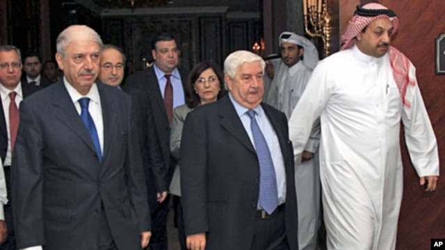 A handout photograph from Syria's national news agency shows Syria's delegation headed by FM Walid Moualem (C), Bouthaina Shaaban (behind Moualem), a political advisor to President Bashar al-Assad, and ambassador to the Arab League Yousef al-Ahmed (L) aft