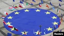 European Union flag lies at the centre of Schuman Square outside European Commission headquarters in Brussels, Belgium, May 8, 2021.