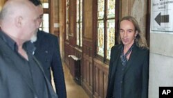 Former Dior designer John Galliano (R) arrives to face charges of using anti-Semitic slurs in a Paris cafe - allegations that shocked the fashion world and cost him his job at the renowned French high-fashion house Dior - at the Paris court house, June 22
