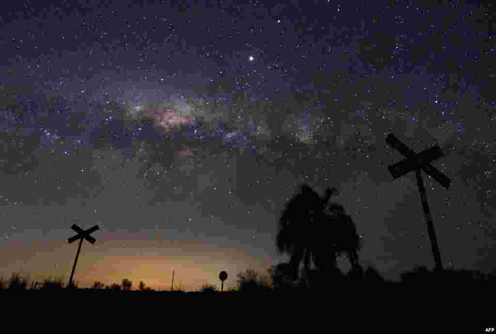 The Milky Way's Galactic Centre and Jupiter (brightest spot at center top) are seen from the countryside near the small town of Reboledo, Uruguay.