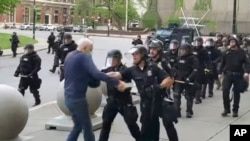 In this image from video provided by WBFO, a Buffalo police officer appears to shove a man who walked up to police June 4, 2020, in Buffalo, N.Y.