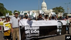 Journalists, rights activists and opposition lawmakers shout slogans and display placards during a demonstration alleging government suppression of media in Colombo, Sri Lanka, January 29, 2013.