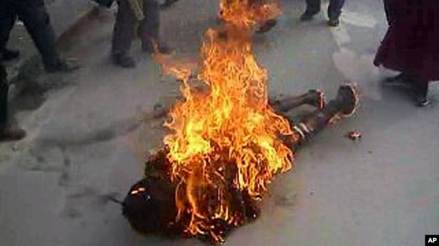 This still image allegedly shows the self-immolation of an individual along a street in Dawu, Ganzi prefecture in Sichuan province.