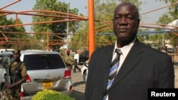 South Sudan's Defence Minister Kuol Manyang Juuk, poses for a photo after a cabinet meeting in Juba January 17, 2014.