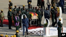 A coffin carrying the body of Zimbabwe's former ruler Robert Mugabe arrives from Singapore, at the RG Mugabe International Airport in Harare, Kenya. Wednesday Sept. 11, 2019. T