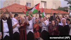 شماری از مظاهره کنندگان که مخالف تصمیم دونالد ترمپ، رئیس جمهور امریکا، مبنی بر به رسمیت شناختن بیت المقدس منحیث پایتخت اسرائیل استند