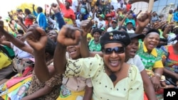 FILE: Women chant party slogans upon the arrival of Zimbabwean President Robert Mugabe for a crucial Zanu PF Poltiburo meeting in Harare, Wednesday Feb. 10, 2016. Mugabe addressed thousand of party supporters and chaired a bitterly divided Zanu pf Politiburo amid heightened tensions over issues to do with factionalism and succession in the party.(AP Photo/Tsvangirayi Mukwazhi)
