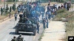 시리아 남부 도시 다라에서 철수하는 정부군들(자료사진)