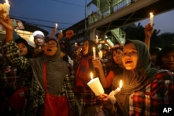 """FILE - Supporters of Jakarta Gov. Basuki """"Ahok"""" Tjahaja Purnama who is imprisoned for blaspheming Islam shout slogans during a protest outside the High Court in Jakarta, Indonesia, May 16, 2017."""