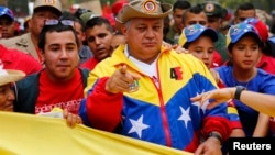 FILE - National Assembly President Diosdado Cabello (C) take part in a rally with a Bolivarian militia in Caracas, March 15, 2014.