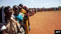 """FILE - Internally displaced people wait to be registered by the International Organization for Migration and the World Food Program, in Wau, South Sudan, May 11, 2016. The U.S. accuses the South Sudanese government of """"choosing arms systems over food for their people."""""""