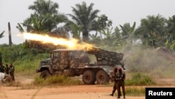 FILE - Congolese soldiers from the Armed Forces of the Democratic Republic of Congo [FARDC] launch missiles during their military operation against Ugandan Islamist group, the Allied Democratic Forces, outside the town of Beni, in North Kivu province, Dem