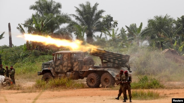 FILE - Congolese soldiers from the Armed Forces of the Democratic Republic of Congo [FARDC] launch missiles during their military operation against Ugandan Islamist group, Allied Democratic Forces, outside Beni, in North Kivu province, Democratic Republic of Congo, January 2014.