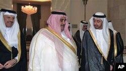 Bahrain's Foreign Minister Sheikh Khaled bin Ahmad al-Khalifa, center, welcomes United Arab Emirates Foreign Minister, Sheik Abdullah bin Zayed Al Nahyan, right, as the New Secretary General of the GCC, Dr. Abdullatif bin Rashid Al-Zayani, smiles at the G