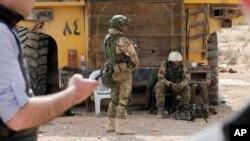 Российские солдаты патрулируют город Пальмиру в провинции Хомс, Сирия. 14 апреля 2016 г
