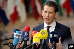FILE - Austrian Chancellor Sebastian Kurz speaks with the media as he arrives for an EU summit in Brussels, March 22, 2018.