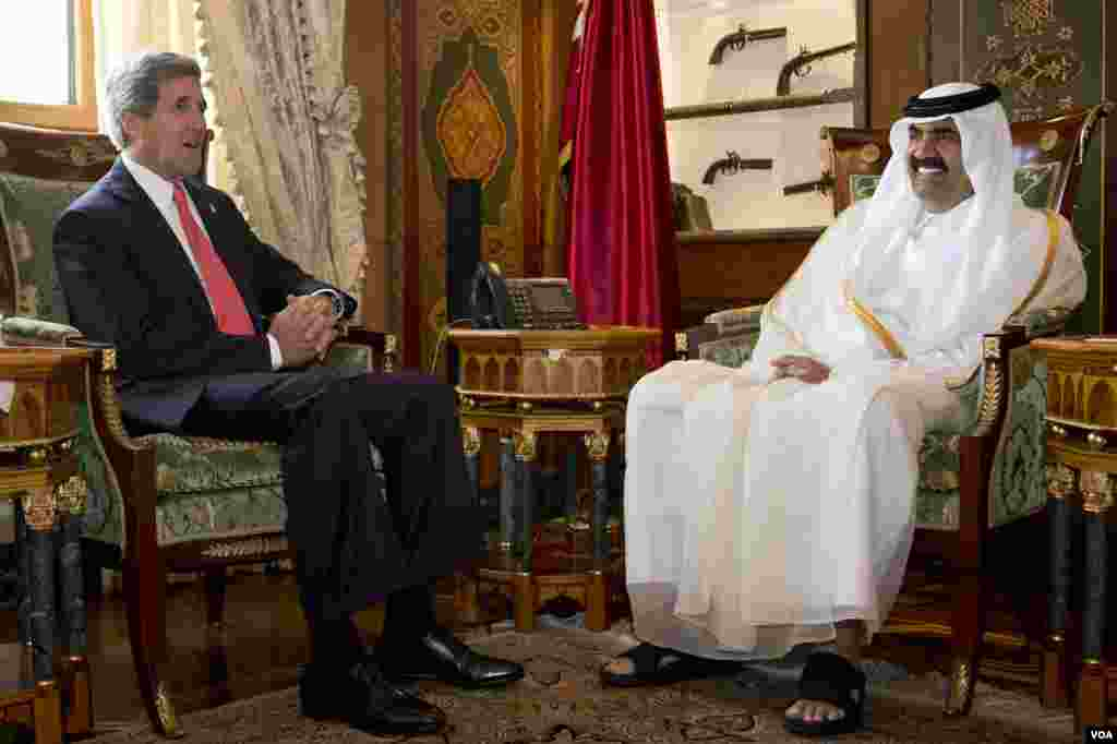 U.S. Secretary of State John Kerry, left, meets with Qatari Emir Hamad bin Khalifa Al Thani at Wajbah Palace in Doha, Qatar, on Sunday, June 23, 2013. In Qatar Kerry spent time discussing Syria and Afghanistan. The meeting is the last event in Qatar befo