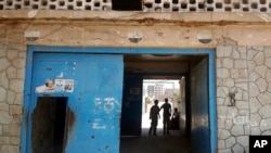 FILE - The entrance of Aden Central Prison, known as Mansoura, where one wing is run by Yemeni allies of the United Arab Emirates, is shown in this May 9, 2017, photo in Aden, Yemen.