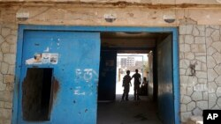 FILE - The entrance of Aden Central Prison, known as Mansoura, where one wing is run by Yemeni allies of the United Arab Emirates to detain al-Qaida suspects, is shown in this May 9, 2017 photo in Aden, Yemen.