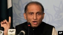 FILE - Pakistan's Foreign Secretary Aizaz Chaudhry gestures during a press conference in Islamabad, Pakistan, May 8, 2015.