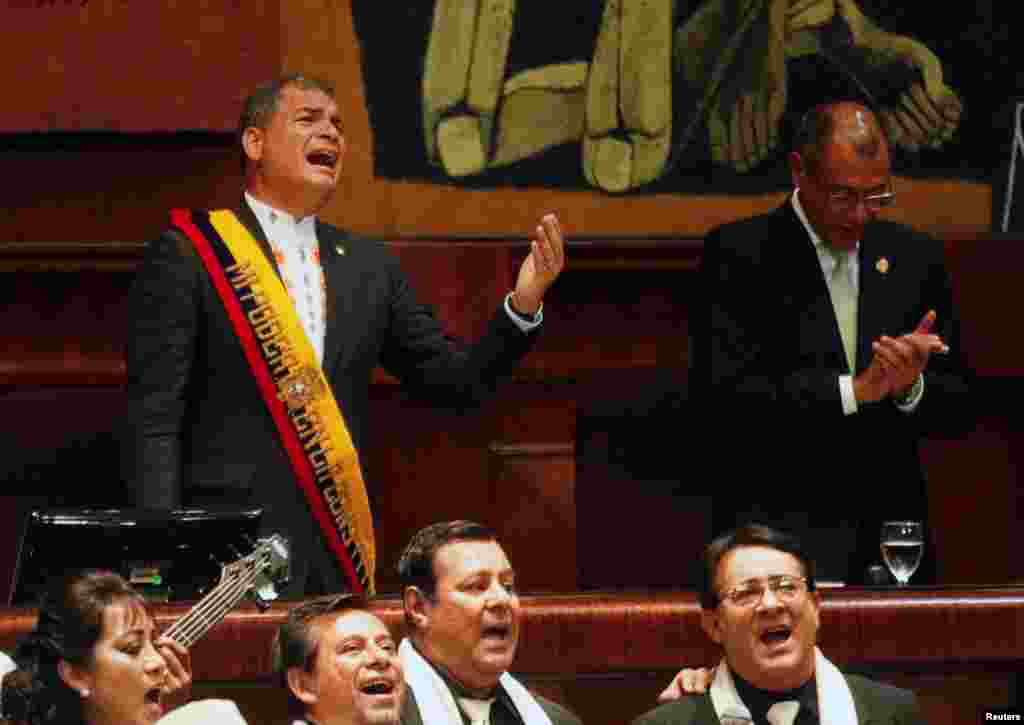 Ecuadorian President Rafael Correa sings during a special ceremony at the National Assembly in Quito.
