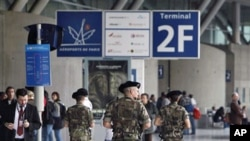 Soldiers patrol at Roissy Charles de Gaulle airport, France, 04 Oct 2010