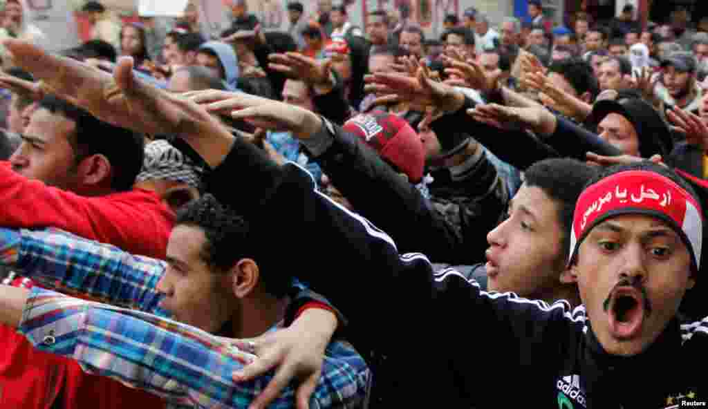 Protesters shout slogans in a march during the second anniversary of the resignation of Hosni Mubarak, at Tahrir Square in Cairo, February 11, 2013.